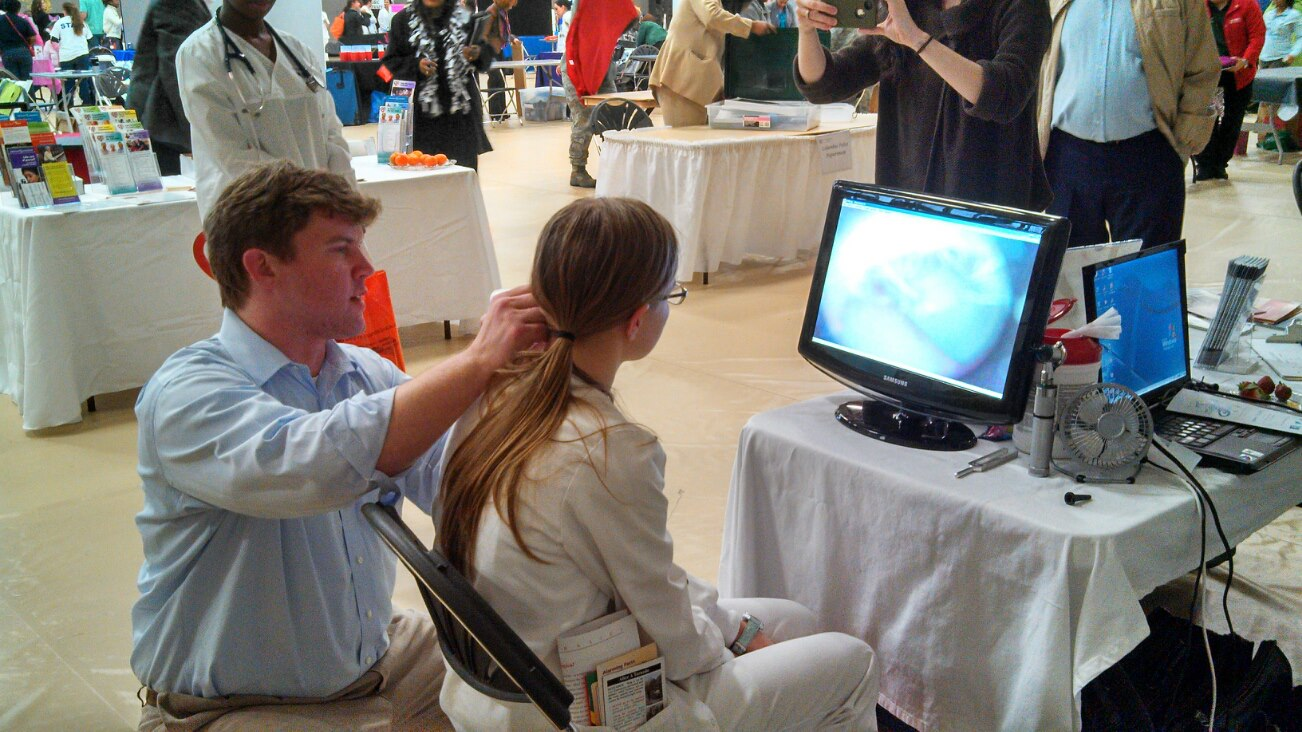 Sam Ford performing hearing screening